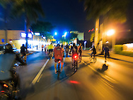 Cyclists in the March 28, 2014 Miami Critical Mass ride travel east on Calle Ocho (SW 8th Street) after dark.<br />