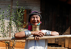 A Padaung woman with brass rings around her neck smiles as she stands in front of her home in Panpet Village, Demoso Township, Kayah State, Myanmar, April 11, 2016. The brass rings are first applied when the Padaung girls are about eight years old and as the girl grows older, longer coils are added up to 24 or 25 rings. EXPA Pictures © 2016, PhotoCredit: EXPA/ Photoshot/ U Aung<br /> <br /> *****ATTENTION - for AUT, SLO, CRO, SRB, BIH, MAZ, SUI only*****