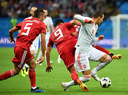 KAZAN, June 20, 2018  Omid Ebrahimi (C) of Iran vies with Rodrigo (R) of Spain during a Group B match between Spain and Iran at the 2018 FIFA World Cup in Kazan, Russia, June 20, 2018. Spain won 1-0. (Credit Image: © Liu Dawei/Xinhua via ZUMA Wire)