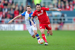 Lee Tomlin of Bristol City is challenged by Corry Evans of Blackburn Rovers - Rogan Thomson/JMP - 22/10/2016 - FOOTBALL - Ashton Gate Stadium - Bristol, England - Bristol City v Blackburn Rovers - Sky Bet EFL Championship.