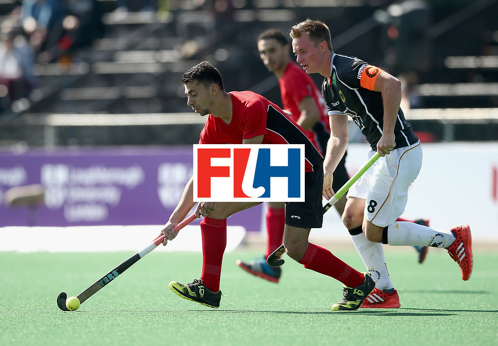 JOHANNESBURG, SOUTH AFRICA - JULY 11: Ashraf Said of Egypt and Mats Grambusch of Germany battle for possession during day 2 of the FIH Hockey World League Semi Finals Pool B match between Germany and Egypt at Wits University on July 11, 2017 in Johannesburg, South Africa. (Photo by Jan Kruger/Getty Images for FIH)