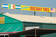 Latino Discount Tires photographed on October 22, 2014 in Irving, Texas. (Cooper Neill for The Texas Tribune)