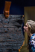El Anatsui (Ghanaian, born 1944), 'Al Haji', signed 'EL 90' (18th plank from base), est £100,000-150,000<br />  - Bonhams previews works from its Africa Now sail - the first contemporary sale of African artists - and its Gutai and ZERO exhibition. In their offices on New Bond Street.