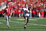 MADISON, WI - OCTOBER 25: Wisconsin University law students participate in the annual Hat and Cane Toss before the football game against the Maryland Terrapins at Camp Randall Stadium on October 25, 2014 in Madison, Wisconsin. (Photo by Joe Robbins)