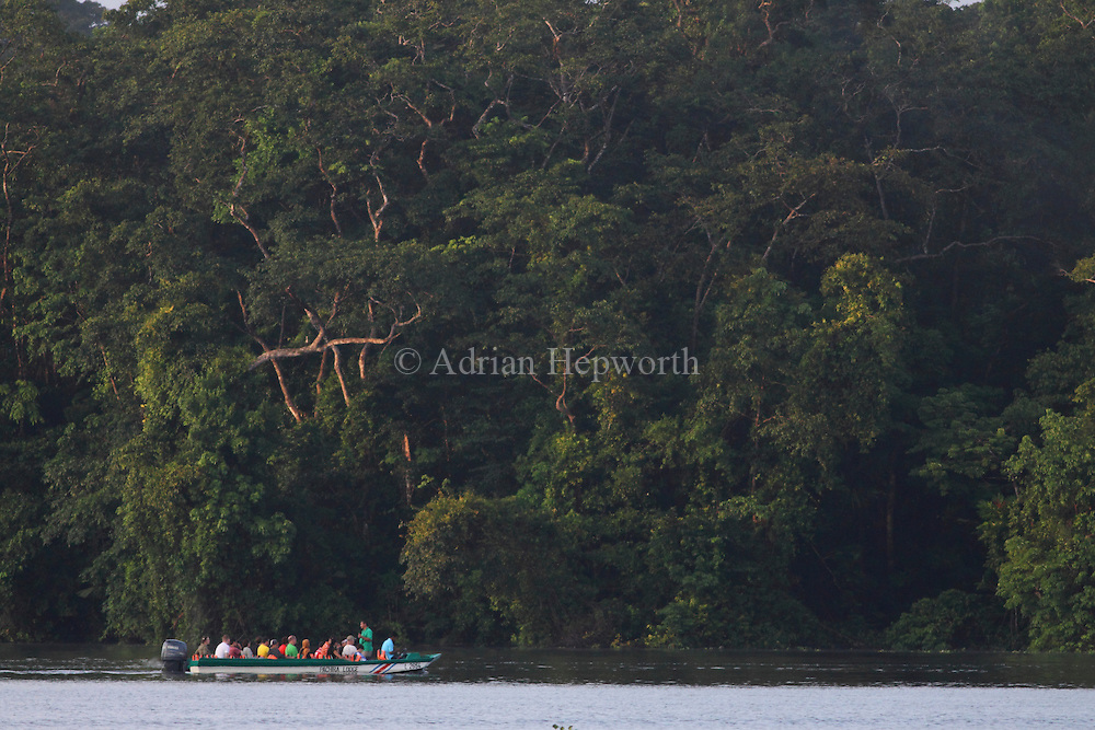 Tourist boat on natural rainforest canal in Tortuguero National Park. Costa Rica. <br />