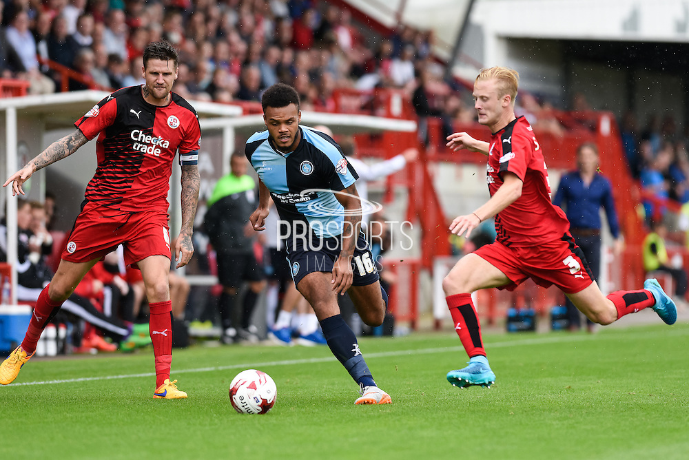 Christian Scales gets to the ball ahead of Aaron Amadi-Holloway during the Sky Bet League 2 match between Crawley Town and Wycombe Wanderers at the Checkatrade.com Stadium, Crawley, England on 29 August 2015. Photo by David Charbit.