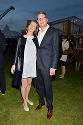 CHLOE DELEVINGNE and ED GRANT at the Battersea Power Station Annual Party at Battersea Power Station, 188 Kirtling Street, London SW8 on 30th April 2014.