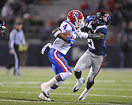 Louisiana Tech's Quinton Patton (4) stiffarms Ole Miss' Senquez Golson (21) in Oxford, Miss. on Saturday, November 12, 2011.