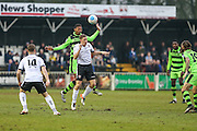 Forest Green Rovers Ethan Pinnock(16) heads the ball forward during the Vanarama National League match between Bromley FC and Forest Green Rovers at Hayes Lane, Bromley, United Kingdom on 7 January 2017. Photo by Shane Healey.