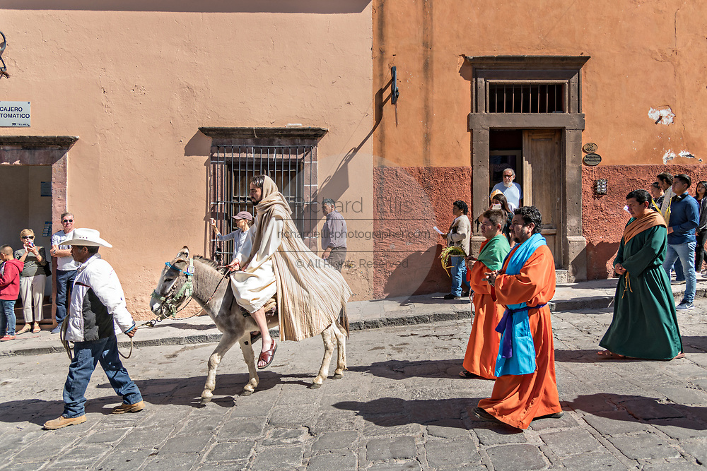Jesus riding a burro leads his disciples in a Palm Sunday procession through the streets at the start of Holy Week March 25, 2018 in San Miguel de Allende, Mexico. Christians commemorate the entry of Jesus into Jerusalem when it was believed that the citizens laid down palm branches in his path.