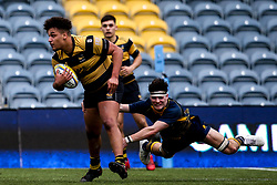 Nic Jakobsen of Wasps U18 is tackled by Jack Forsythe of Worcester Warriors U18 - Mandatory by-line: Robbie Stephenson/JMP - 28/12/2019 - RUGBY - Sixways Stadium - Worcester, England - Worcester Warriors U18 v Wasps U18 - Premiership U18 Academy