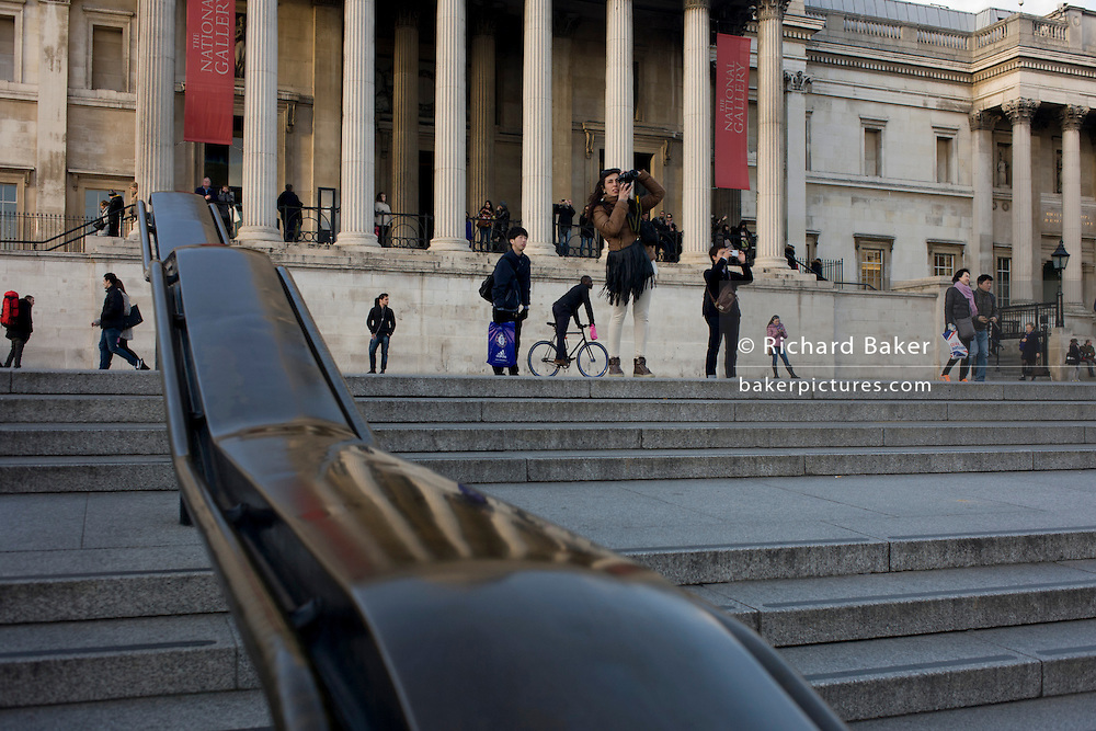 Visitors in pedestrian zone outside the National Gallery in Trafalgar Square, central London.