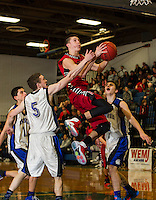 Belmont's Chris Duggan goes up for a shot against Winnisquam's Marshall Bordeau during Tuesday evenings  boys semi final in the 41st annual Holiday Basketball Tournament at Gilford High School.  (Karen Bobotas/for the Laconia Daily Sun)