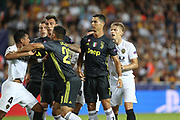 Cristiano Ronaldo of Juventus FC argues with Medhi Benatia of Valencia CF during the UEFA Champions League, Group H football match between Valencia CF and Juventus FC on September 19, 2018 at Mestalla stadium in Valencia, Spain - Photo Manuel Blondeau / AOP Press / ProSportsImages / DPPI