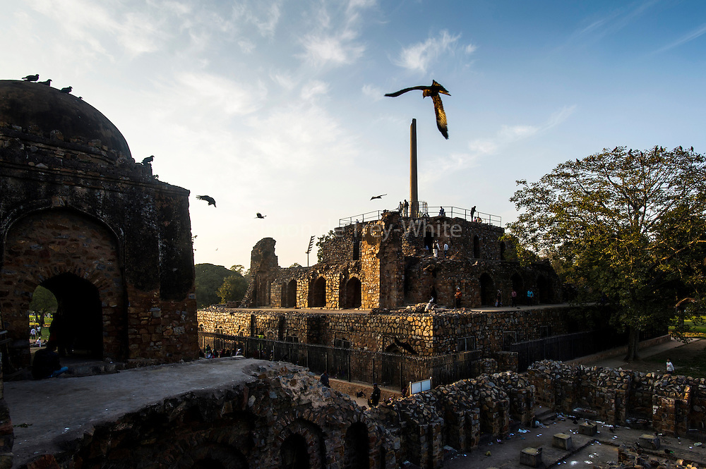 "5th February 2015, New Delhi, India. View of the three-tiered arcaded pavilion with an Ashokan Pillar atop it in the ruins of Feroz Shah Kotla on the 5th February 2015<br /> <br /> PHOTOGRAPH BY AND COPYRIGHT OF SIMON DE TREY-WHITE a photographer in delhi. + 91 98103 99809. Email:simon@simondetreywhite.com<br /> <br /> People have been coming to Firoz Shah Kotla to leave written notes and offerings for Djinns in the hopes of getting wishes granted since the late 1970's. Jinn, jann or djinn are supernatural creatures in Islamic mythology as well as pre-Islamic Arabian mythology. They are mentioned frequently in the Quran  and other Islamic texts and inhabit an unseen world called Djinnestan. In Islamic theology jinn are said to be creatures with free will, made from smokeless fire by Allah as humans were made of clay, among other things. According to the Quran, jinn have free will, and Iblīs abused this freedom in front of Allah by refusing to bow to Adam when Allah ordered angels and jinn to do so. For disobeying Allah, Iblīs was expelled from Paradise and called ""Shayṭān"" (Satan).They are usually invisible to humans, but humans do appear clearly to jinn, as they can possess them. Like humans, jinn will also be judged on the Day of Judgment and will be sent to Paradise or Hell according to their deeds. Feroz Shah Tughlaq (r. 1351–88), the Sultan of Delhi, established the fortified city of Ferozabad in 1354, as the new capital of the Delhi Sultanate, and included in it the site of the present Feroz Shah Kotla. Kotla literally means fortress or citadel."