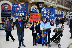 Put it to the People demonstration in central London against Brexit and an appeal for a Peoples Vote on a final Deal. Family at Charing Cross station before the march. London UK 23 March 2019