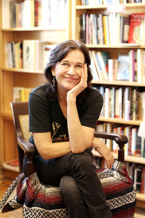 "Author Louise Erdrich photographed in her bookstore, Birchbark Books and Native Arts, in Minneapolis, MN, September 27, 2012.  Erdrich's new book is ""The Round House."" The novel is about a woman who suffers psychological trauma after an attack, and her son tries to help by visiting the Round House, a sacred space and place of worship for the Ojibwe. (Courtney Perry/for the Chicago Tribune).."
