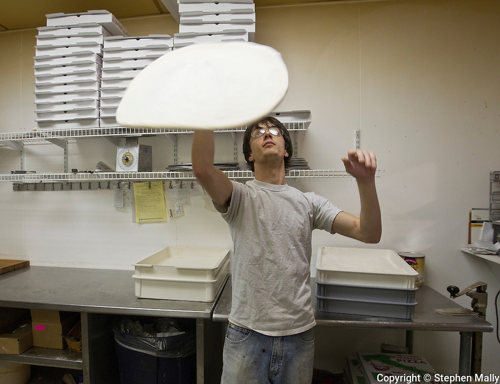 Aaron Schilling throws dough as he works at Saint Giuseppe's Heavenly Pizza in Moline, Illinois on Tuesday November 9, 2010. The pizza shop is owned by Congressman-elect Robert Schilling (IL-17).
