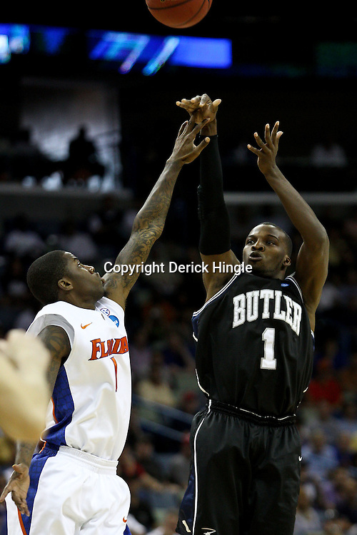 Mar 26, 2011; New Orleans, LA; Butler Bulldogs guard Shelvin Mack (1) shoots over Florida Gators guard Kenny Boynton (1) during the first half of the semifinals of the southeast regional of the 2011 NCAA men's basketball tournament at New Orleans Arena.   Mandatory Credit: Derick E. Hingle
