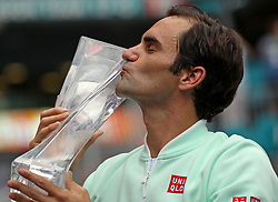 Roger Federer, of Switzerland, kisses the trophy after defeating John Isner, of the United States, 6-1, 6-4 during the final of the Miami Open tennis tournament at Hard Rock Stadium on Sunday, March 31, 2019, in Miami Gardens, Fla. Photo by David Santiago/Miami Herald/TNS/ABACARESS.COM
