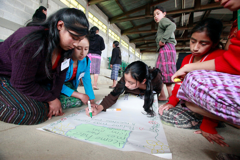"Adolescent girls make posters at the ChildFund project 'Mujeres Seguras"", where adolescent mentors are trained to provide instruction in preventing gender violence in their communities, Chichicastenango, Guatemala, Tuesday, Aug. 30, 2011. Television star and Girl Up Champion Victoria Justice is here to learn about Girl Up's work to support the work of the United Nations to help girls in developing countries. (Stuart Ramson/Insider Images for UN Foundation)"