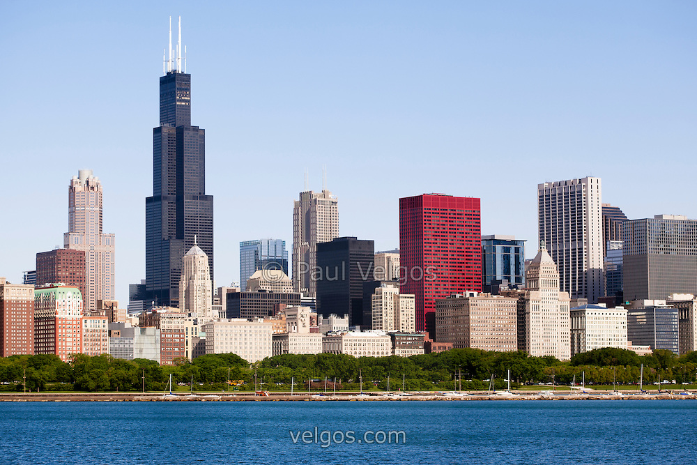 Photo of Chicago skyline downtown city buildings with the famous Willis Tower (Sears Tower) one of the tallest buildings in the world. Picture is was taken in May 2010 and is high resolution.