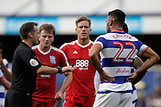 Stephen Gleeson and Steven Caulker after Caulker took a hit to the head during the EFL Sky Bet Championship match between Queens Park Rangers and Birmingham City at the Loftus Road Stadium, London, England on 24 September 2016. Photo by Jarrod Moore.