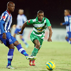 PIETERMARITZBURG, SOUTH AFRICA - MARCH 19: Ruben Cloete of Maritzburg Utd with a pass back to Shu-aib Walters G/K of Maritzburg Utd during the Absa Premiership match between Maritzburg United and Bloemfontein Celtic at Harry Gwala Stadium on March 19, 2014 in Pietermaritzburg, South Africa. (Photo by Steve Haag/Gallo Images)