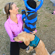 Meredith McCumbee laughs with Aaron McCumbee,4, and their dog Hattie before the Paws for People 5K. (Jason A. Frizzelle)
