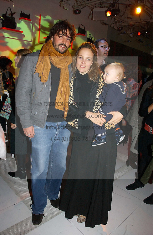 TOM CRAIG and BAY GARNETT and their son BILLY CRAIG at a party to celebrate the launch of DKNY Kids and Halloween in aid of CLIC Sargent and RX Art held at DKNY, 27 Old Bond Street, London on 31st October 2006.<br />