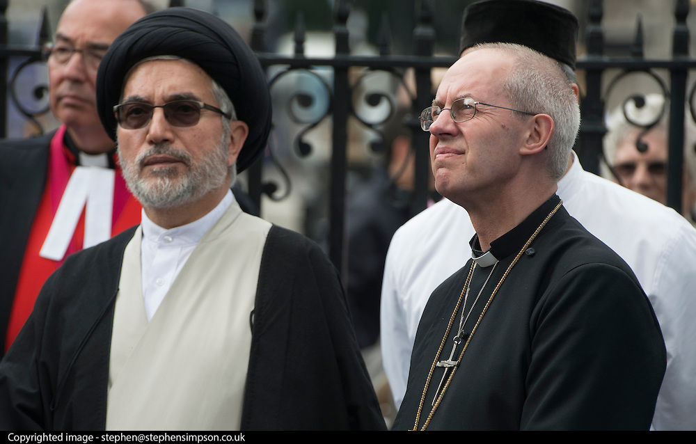 © Licensed to London News Pictures. 03/09/2014. London, UK. Ayatollah Dr Sayed Fazel Milani stands with Justin Welby.  The Archbishop of Canterbury, Justin Welby, attends an inter-faith vigil outside Westminster Abbey. Other speakers include Imam Ibrahim Mogra of the Muslim Council of Britain, Rabbi Laura Janner-Klausner of the Movement for Reform Judaism and Ayatollah Dr Sayyid Fadhil H Al-Milani.. Photo credit : Stephen Simpson/LNP