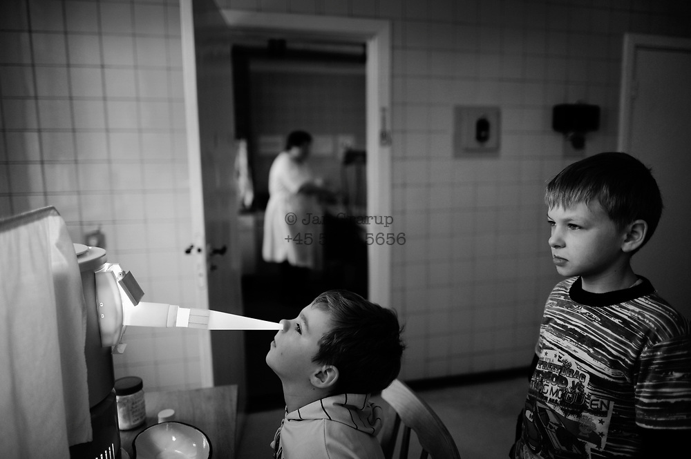 On April 26 - 2011.25 years after the Chernobyl disaster people are still suffering from the long term consequences of a nuclear meltdown. Countries affected struggle with cronic illness, contaminated food - For many their life ended with Chernobyl...<br /> Boys going thru medical treatment at the Clinical Radiologu Institute in Kiev - stil amny children are admitted to hospital for long term treatment due to their bad health related to the chernobyl disaster 25 years ago. 25 years after the nuclear disaster at the Chernobyl power plant in Ukraine, the country are still suffering from sickness and pollution. children in the villages like Drosdyn suffer from general bad health and are admitted to hospitals in the capitol Kiev.
