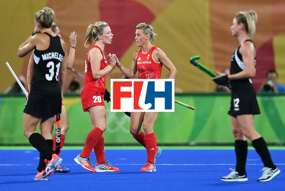 Britain's Alex Danson (2nd R) celebrates a goal with Britain's Hollie Webb (2nd L) during the women's semifinal field hockey New Zealand vs Britain match of the Rio 2016 Olympics Games at the Olympic Hockey Centre in Rio de Janeiro on August 17, 2016. / AFP / MANAN VATSYAYANA        (Photo credit should read MANAN VATSYAYANA/AFP/Getty Images)