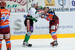 Fight between Jure Stopar (HDD Tilia Olimpija, #86) and Jure Dolinsek (HK Acroni Jesenice, #22) during ice-hockey match between HK Acroni Jesenice and HDD Tilia Olimpija in fourth game of Final at Slovenian National League, on April 8, 2011 at Dvorana Podmezaklja, Jesenice, Slovenia. (Photo By Matic Klansek Velej / Sportida.com)