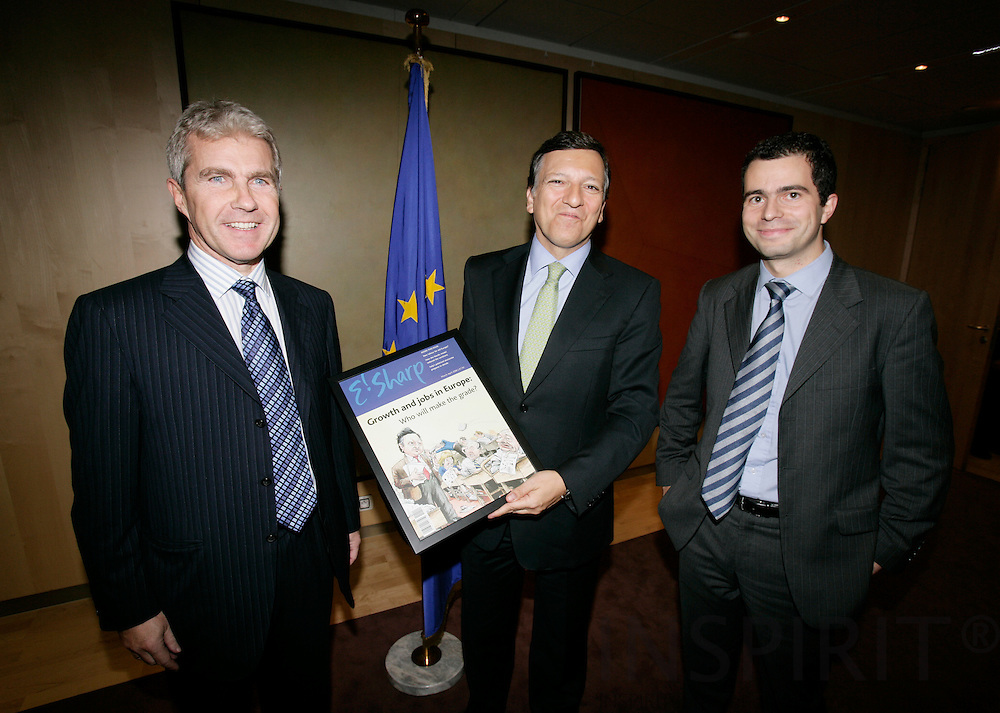 BRUSSELS - BELGIUM - 08 NOVEMBER 2006 -- Jose Manuel BARROSO, President of the EU Commission recieving a frontpage of E'Sharp from publisher Paul ADAMSON (L) and editor Simon O'Connor (R).   PHOTO: ERIK LUNTANG /