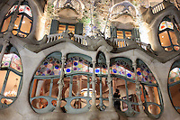 Casa Battlo in downtown Barcelona, Spain is one of Antonio Gaudi's most famous buildings. Here it is lit up at night, showing the curved windows and lines that makes it a tourism icon.
