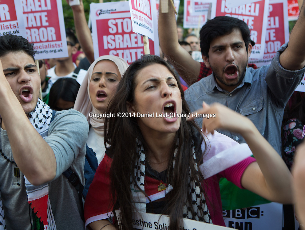 Image ©Licensed to i-Images Picture Agency. 15/07/2014. London, United Kingdom. Demonstration against BBC Israel-Palestine reporting. A demonstrator against Israeli strikes on Gaza shouts in front of the BBC in a demonstration opposing their way of reporting the conflict. the BBC. Picture by Daniel Leal-Olivas / i-Images