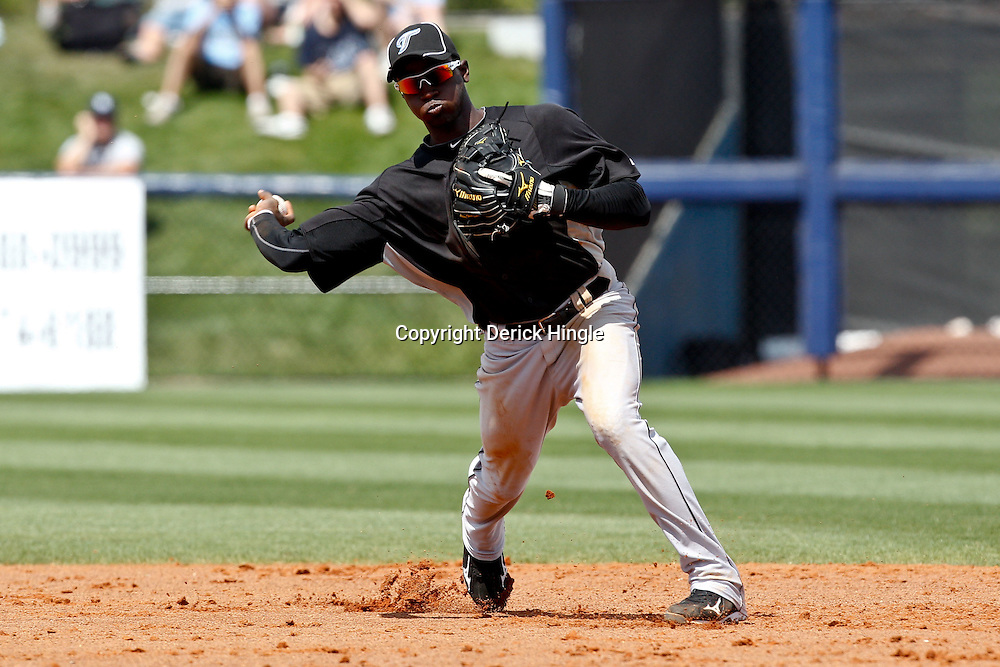 March 8, 2011; Port Charlotte, FL, USA; Toronto Blue Jays shortstop Adeiny Hechavarria (3) during a spring training exhibition game against the Tampa Bay Rays at Charlotte Sports Park.   Mandatory Credit: Derick E. Hingle