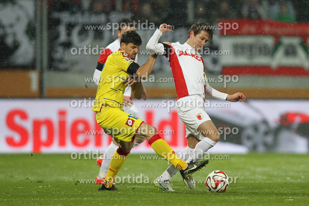 01.02.2015, SGL Arena, Augsburg, GER, 1. FBL, FC Augsburg vs TSG 1899 Hoffenheim, 18. Runde, im Bild l-r: im Zweikampf, Aktion, mit Tobias Strobl #12 (TSG 1899 Hoffenheim) und Paul Verhaegh #2 (FC Augsburg) // during the German Bundesliga 18th round match between FC Augsburg and TSG 1899 Hoffenheim at the SGL Arena in Augsburg, Germany on 2015/02/01. EXPA Pictures &copy; 2015, PhotoCredit: EXPA/ Eibner-Pressefoto/ Kolbert<br /> <br /> *****ATTENTION - OUT of GER*****