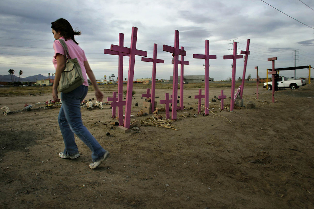 In the sprawling Mexican border town of Ciudad Ju?rez, home to a legion of maquiladoras, or foreign export assembly plants, industrial work, foreign money and desperation fuel an ongoing mystery that has plagued the town for years...In the last nine years, more than 300 young women have either been kidnapped or disappeared. Some are found dead, their bodies dumped and hastily buried outside town. The vast majority are never heard from again, their families left wondering, assuming the worst...Organized crime and prostitution are rife, but the women and their families that populate Ju?rez?s slums keep coming, hoping to be one of the estimated one million Mexican workers employed at some 3,000 maquiladoras for between $4 and $9 a day. ..But the factories ? their proximity to the U.S. border and the influx of foreigners and U.S. dollars they bring ? also attract a darker kind of industry. ..Drug cartels and prostitution have flourished in Ju?rez, thriving on Americans who cross the border with relative ease. Money can buy anything on the streets of Ju?rez, including sex with a young girl for as little as $20 and the silence of corrupt police and officials...Trying to navigate the layers of crime and corruption behind the mystery of Ju?rez?s disappeared can be deadly, but a handful of hardened human rights groups shoulder the burden. Activists at the Ju?rez-based Casa Amiga help grieving families cope with their loss and raise awareness about the dangerous risks women take to make a meager living in Ju?rez...The group has blanketed the town with the pink crosses that have come to symbolize Ju?rez?s missing women. Large pink crosses also mark a mass grave where women?s bodies were found...