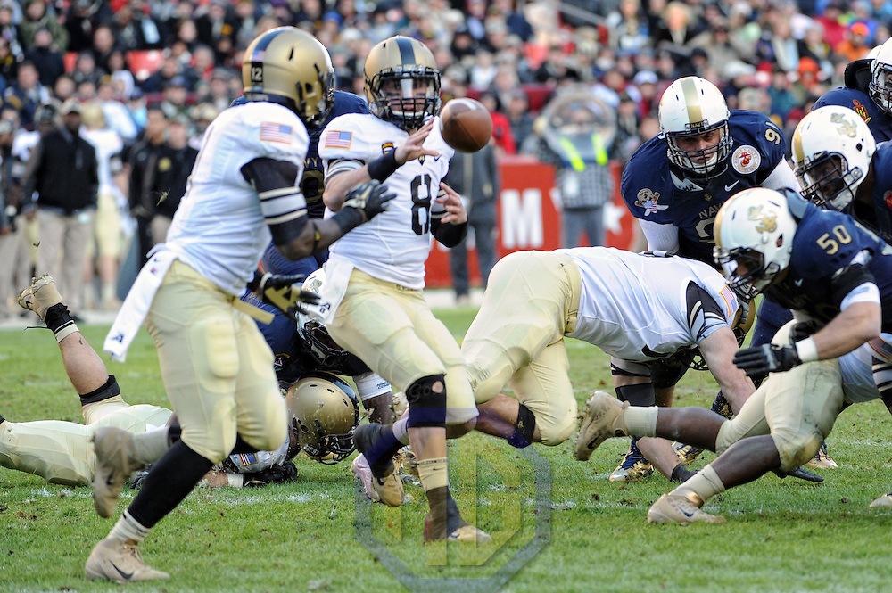10 December 2011:   Army Black Knights quarterback Trent Steelman (8) tosses the ball action against the Navy Midshipmen at Fed Ex field in Landover, Md.  in the 112th annual Army Navy game where Navy defeated Army, 27-21 for the 10th consecutive time..