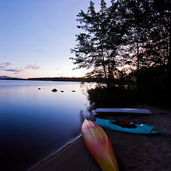 Kayaks on the shore of Umbagog Lake at dawn.  Umbagog Lake State Park, Cambridge, New Hampshire.