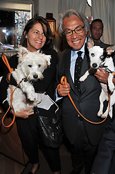 SIR DAVID TANG, his wife LUCY  and their dogs at the 10th anniversary of George in association with The Dog's Trust held at George, 87-88 Mount Street, Mayfair, London on 13th September 2011.
