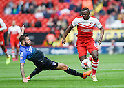 Igor Vetokele keeps possession under pressure from Steve Cook during the Sky Bet Championship match between Charlton Athletic and Bournemouth at The Valley, London, England on 2 May 2015. Photo by David Charbit.