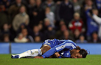 Photo: Paul Thomas.<br /> Chelsea v Levski Sofia. UEFA Champions League, Group A. 05/12/2006. <br /> <br /> Didier Drogba of Chelsea gets knocked down by the Levski keeper Bozhidar Mitrev, whick needs treatment.