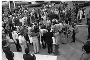 1983-15-08.15th August 1983.15-08-1983.08-15-83..Pressed:..Photographed at Dublin Airport..Gold medalist Eamonn Coughlan geeeted by press and supporters on the tarmac of Dublin Airport on his return from the World Athletic Championships in Helsinki, Finland. His wife Yvonne and chldren Suzanne (four) and Eamonn Jn (two) are with him. Suzanne is in his arms while his wife holds Eamonn Jn. His mother Kathleen is beside Yvonne...
