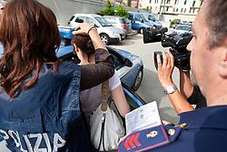 """10.06.2011, Questura di Udine, ITA, Wiener Betonleichen Morde. Italienische Polizeieinheiten haben Freitag früh die gesuchte Eissalonbesitzerin Goidsargi Estibaliz C. im Ortszentrum von Udine, Italien, verhaftet. Demnach wurde die 32-Jährige Chefin des Eissalon """"Schleckeria""""  von mobilen Einheiten in der Nähe des Bahnhofs gestellt. .Gegen Goidsargi Estibaliz C. bestand nach dem Fund von Teilen zweier einbetonierter Leichen in ihrem Kellerabteil in Wien Meidling ein EU-Haftbefehl. Verdächtigt wurde die gebürtige Spanierin, nachdem diese nach der Entdeckung der Leichen anfangs dieser Woche die Flucht ergriffen hatte. Eine der Leichen ist ihr vermisster Ex-Freund Manfred H. Vom zweiten Toten wurde bisher nur der Kopf gefunden, es dürfte sich dabei um ihren deutschen Ex-Ehemann Manfred H. handeln..Hier im Bild Eissalonbesitzerin Goidsargi Estibaliz C wird von zwei Fahrzeugen der Polizia ins italienische Staatsgefängnis nach Triest gebracht, wo der zuständige Untersuchungsrichter über die Auslieferung der Frau nach Österreich entscheiden wird..Für die unter Mordverdacht stehende Goidsargi Estibaliz C., gilt die Unschuldsvermutung! .EXPA Pictures © 2011, PhotoCredit: EXPA/ J. Groder"""