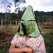 An indigenous U'wa girl wears a cocara leaf. When U'wa girls begin to menstruate they traditionally wear the leaf in public until they are married.<br />