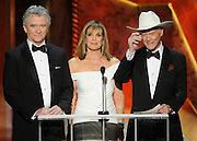 Patrick Duffy, Linda Gray and Larry Hagman present Ensemble in a Drama Series. The 18th Annual Screen Actors Guild Awards were held at the Shrine Exposition Center in Los Angeles, CA 1/29/2012(John McCoy/Staff Photographer)