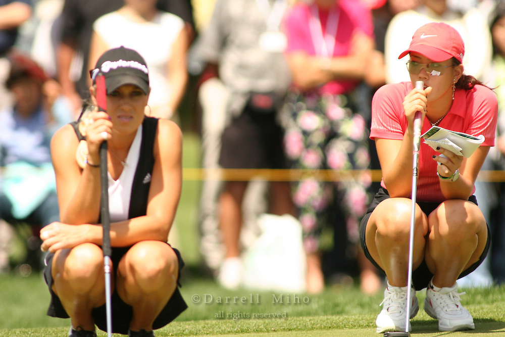 Apr. 2, 2006; Rancho Mirage, CA, USA; .Natalie Gulbis (left) and Michelle Wie (right) watch as Lorena Ochoa (not pictured) putts on the 13th green at the Kraft Nabisco Championship at Mission Hills Country Club. ..Mandatory Photo Credit: Darrell Miho.Copyright © 2006 Darrell Miho .